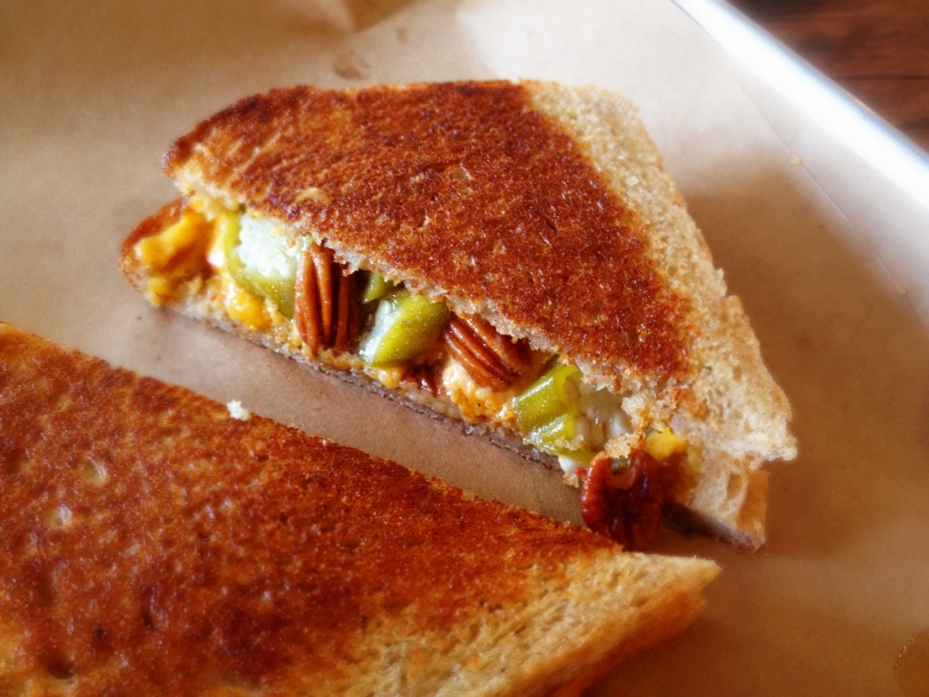 At Butcher & Bee in Charleston, fans can find out the daily specials through Facebook and Twitter.  A past grilled cheese favorite featured pickled okra, candied pecans, and pimento cheese.  www.butcherandbee.com