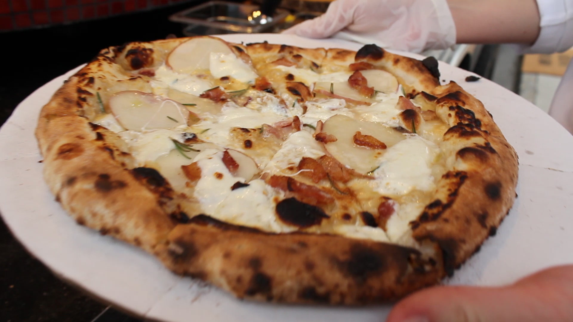 Luna Bon is topped with Roasted Rosemary Potato, Bacon, Whipped Ricotta and Truffle Oil.