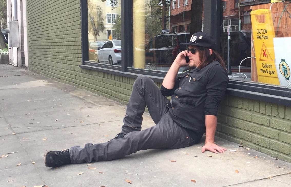 Actor Norman Reedus taking a quick break during production of his TV show